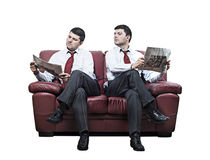 Two men on a red sofa Royalty Free Stock Photo