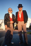Two men in red vests taking a walk in Santa Monica, CA Stock Photos