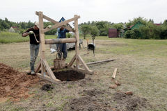 Two men removed the soil from the well stock photo