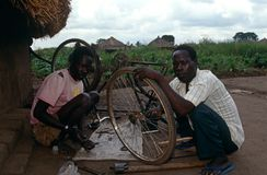Two men repairing a bicycle, Malawi. Stock Photography