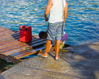 Two men repairing a dock in the windward islands Royalty Free Stock Photo