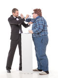 Two men resorting to fisticuffs Stock Images