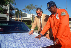Two men reviewing blueprints Stock Images