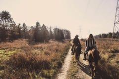 Two Men Riding on Brown Horse Stock Photos