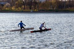 Two men are riding a kayak stock photo