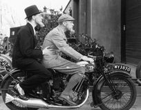 Two men riding a motorbike. (All persons depicted are no longer living and no estate exists. Supplier grants that there will be no model release issues Royalty Free Stock Photo