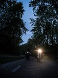 Two Men Riding Motorcycle on Road during Nighttime stock photos