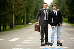Two Men On The Road With Rollerblades royalty free stock image