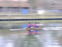 Two Men In A Row Boat Royalty Free Stock Photography