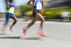 Two men running Royalty Free Stock Photo