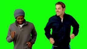 Two men running on green screen stock video