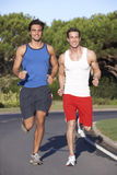 Two Men Running On Road Royalty Free Stock Photography