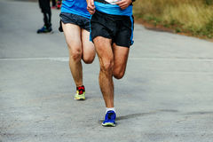 Two men running runners to compete in marathon Royalty Free Stock Photo