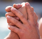 Two men`s hands in comparison strength.  Royalty Free Stock Image