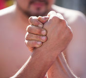 Two men`s hands in comparison strength.  Stock Photo