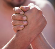 Two men`s hands in comparison strength.  Royalty Free Stock Photography