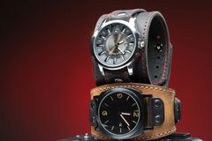 Two men's watches with wide leather bracelet Stock Photography