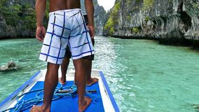 Two Men Sailing In The Beautiful Tropical Sea. Two Men Sailing In The Beautiful Tropical Sea Of Palawan, Philippines stock video footage