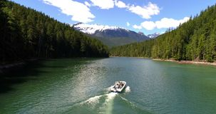 Two men sailing in the boat on a sunny day 4K 4k. Aerial view of two men sailing in the boat on a sunny day 4K 4k stock video footage