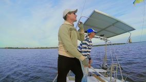 Two men on sailing yacht, speed, active rest, regatta, sports. Stock footage stock footage