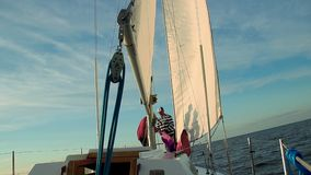 Two men sailors working on deck, yachting, sailing, sport. Stock footage stock video footage