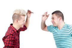 Two men with scissors aiming each other Royalty Free Stock Image
