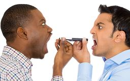 Two men screaming on opposite ends of phone Royalty Free Stock Photo