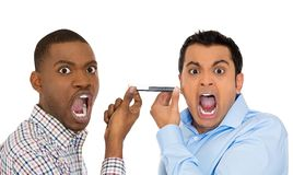 Two men screaming on opposite ends of phone Royalty Free Stock Photos