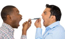 Two men screaming on opposite ends of phone Royalty Free Stock Images