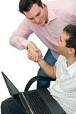 Two men shaking hands with laptop Royalty Free Stock Photos