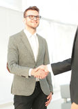 Two men shaking hands and looking at each other with smile Stock Photos