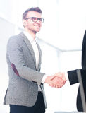 Two men shaking hands and looking at each other with smile Stock Photography