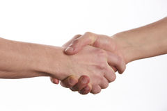 Two men shaking hands over isolated white background. Closeup image of a Business handshake. Business handshake and business people concept. Two men shaking Stock Photography