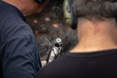 Just Fired Shotgun Smokes With One Shell Left In Chamber. Two men shoot clay targets and reload for more Royalty Free Stock Photo