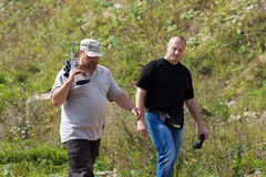 Two men at the shooting range Stock Image
