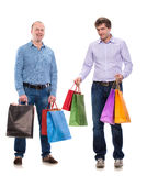 Two men with shopping bags Royalty Free Stock Photography