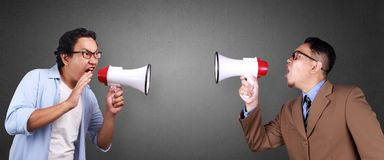 Two Men Shouting at Each Other with Megaphone stock photography