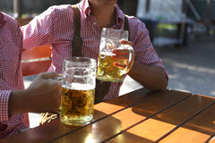 Two men sitting in a beer garden Stock Images