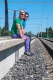 Two men sitting on platform Stock Image