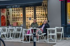 Two men sitting on the terrace of a cafeteria in Bordeaux, France, in September 2013 royalty free stock image