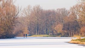 Two men skating on nature ice Stock Photo