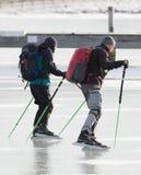 Two men skating Royalty Free Stock Photo