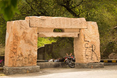 Two men sleeping under shade. Udaipur, India July 2015 : Two men sleeping under the shade of atree on a hot sunny afternoon with their bike parked near them Stock Photo