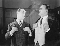Two men smoking cigars Royalty Free Stock Images