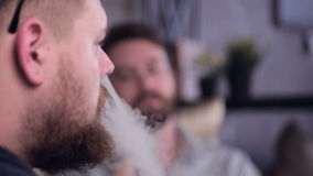 Two men smoking electronic smoking electronic cigarette. Smoke, fume. HD stock video