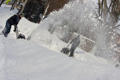 Two Men Snowblowing After a Blizzard Stock Images