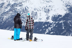 Two men with snowboards prepare for slope Royalty Free Stock Images