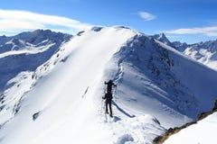 Two men snowshoe hiking on mountain snow arete and panorama in Stubai Alps. Austria Stock Image