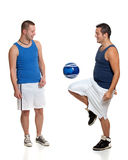 Two men with soccer ball Stock Photo