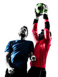 Two men soccer player goalkeeper catching heading ball competiti Royalty Free Stock Photography